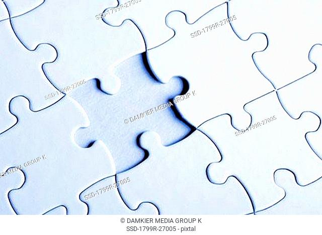 Close-up of a jigsaw puzzle with a missing piece