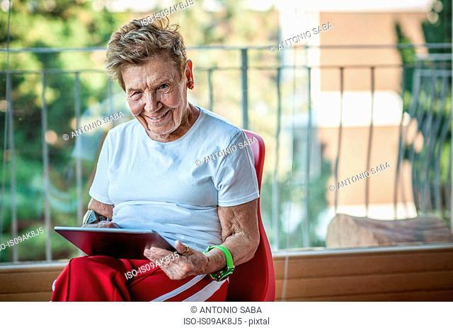 Portrait of a very senior woman using digital tablet