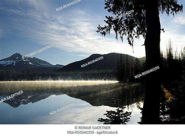Morning mist rising off Sparks Lake with Broken Top mountain