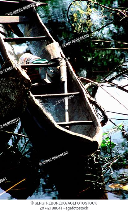 A boat and gun in the Orinoco River. The Warao are an indigenous people inhabiting northeastern Venezuela and western Guyana