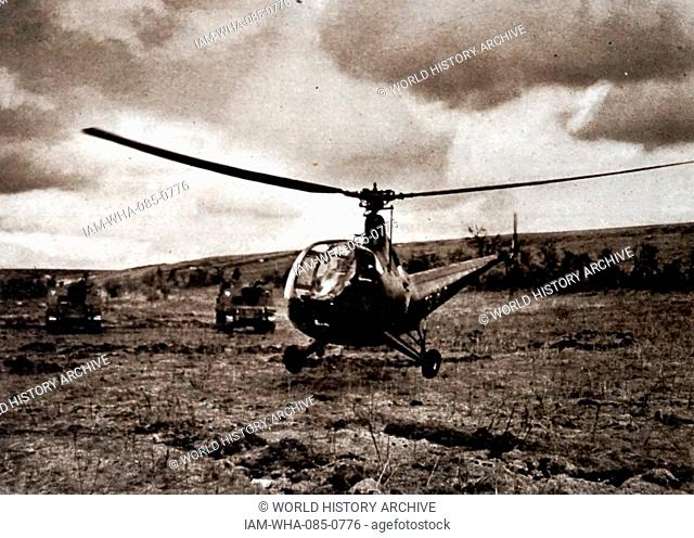 Photograph a Helicopter landing in a very small area. Dated 20th Century