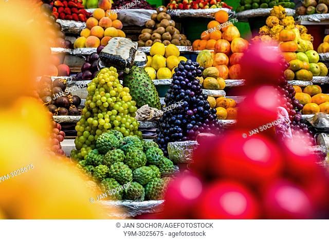 Piles of fruits (wine grapes, chirimoyas, guanabanas, mangostinos, apples etc. ) are seen arranged at the fruit market of Paloquemao in Bogotá, Colombia
