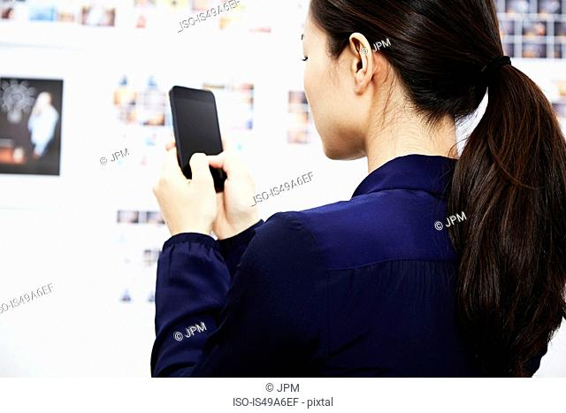 Young woman using smartphone