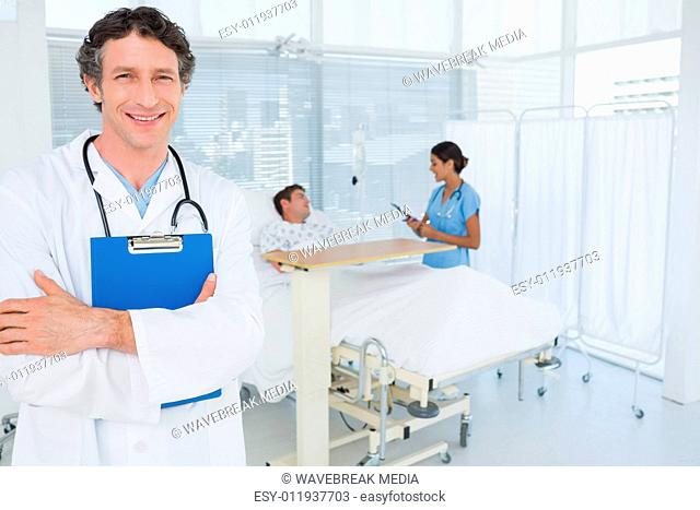 Smiling doctor holding patients file