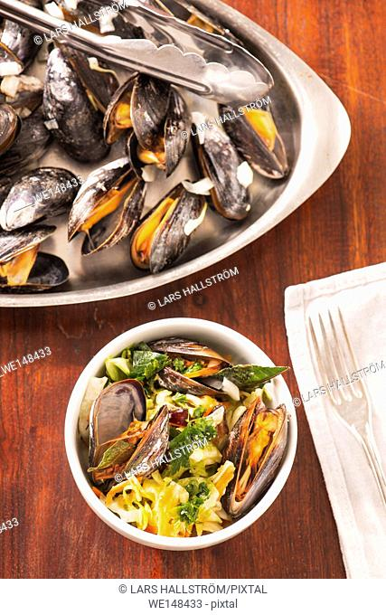 Roasted clams with asian coleslaw. Seafood dish served. Rustic gourmet shellfish dinner