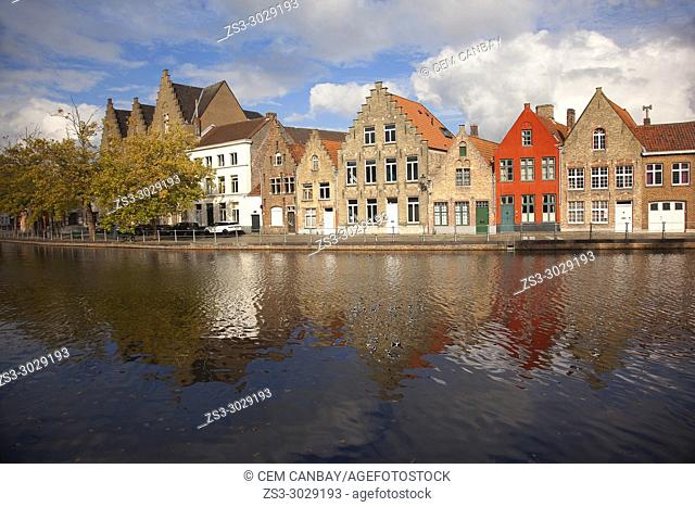 Colorful traditional buildings by the canal at the historic center, Bruges, West Flanders, Belgium, Europe