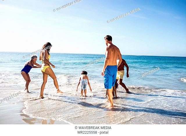 Cute family playing in the water