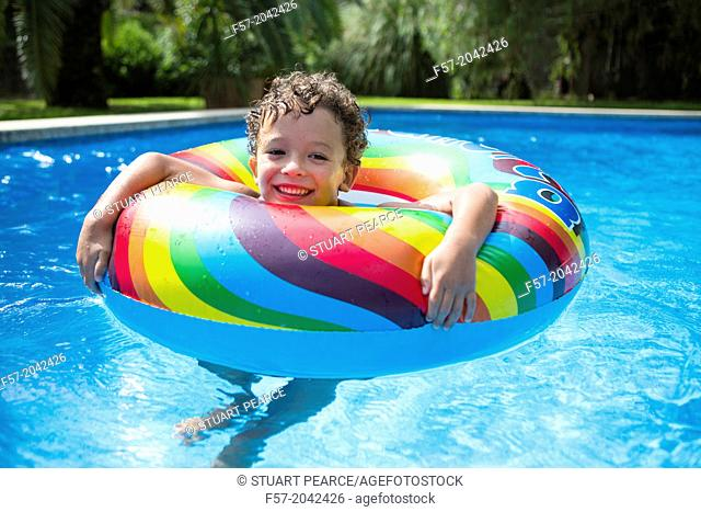 Young boy enjoys summer in the pool