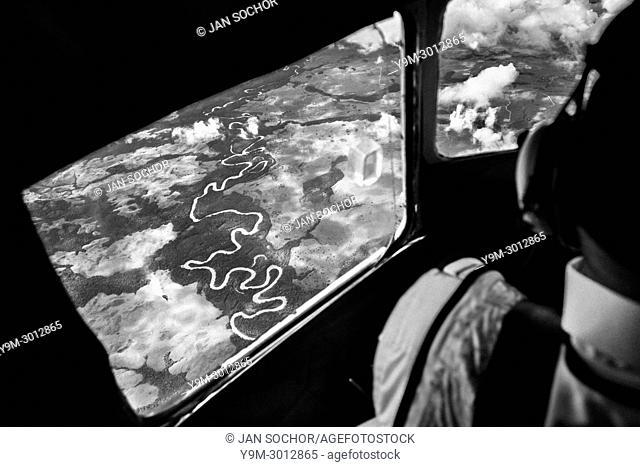Captain Claudio Petro, a Colombian airline pilot, flies a Douglas DC-3 aircraft above Los Llanos, the vast savannas in the remote department of Guainía