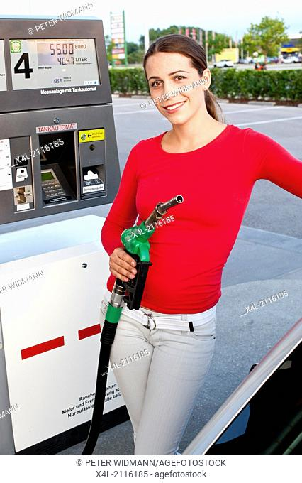 young woman at gas station (model-released)