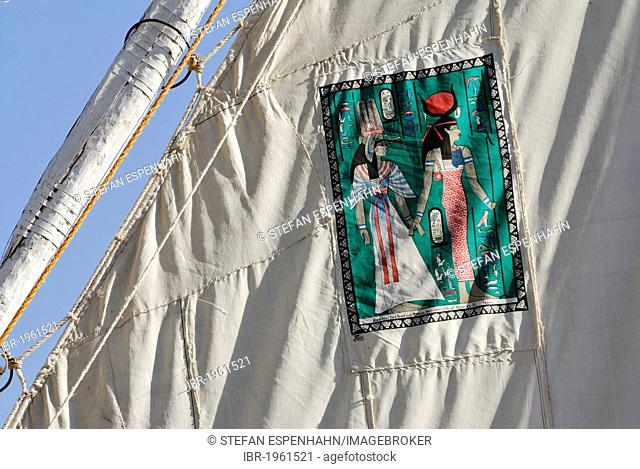 Egyptian motif decorating the sail of a felucca, a traditional wooden sailing boat on the Nile, Aswan, Nile Valley, Egypt, Africa