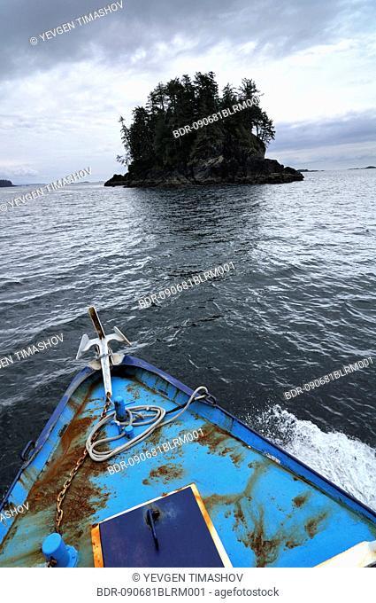 boat near small island at pacific rim national park