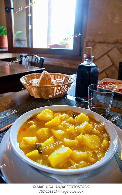 Stew of potatoes in a rustic restaurant. Lozoya, Madrid province, Spain