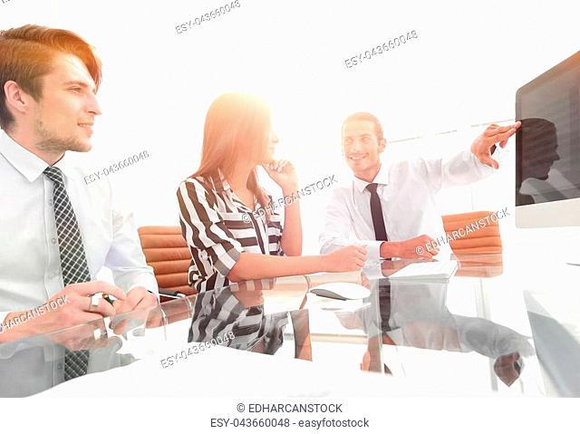 closeup. business team discussing sales statistics