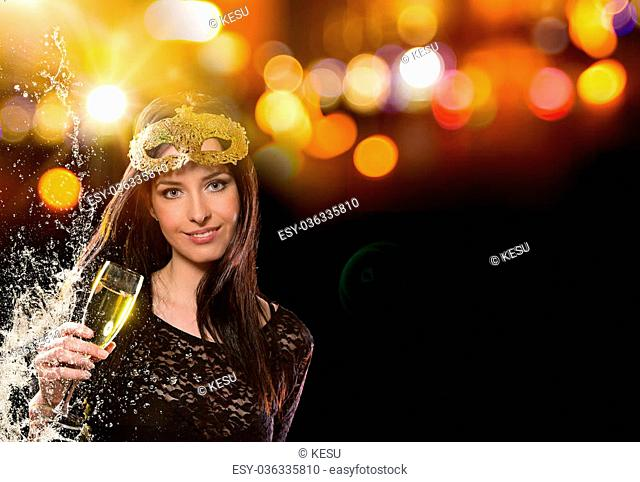 Happy young girl celebrating with glass of champagne