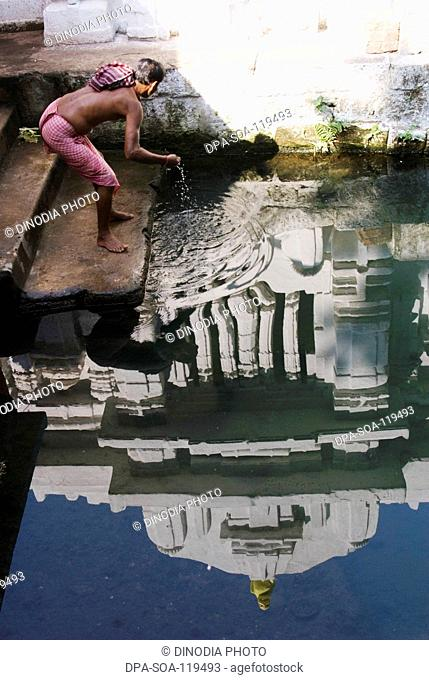 Reflection in ritual pond of 11th century Brahmeshwar temple dedicated to lord Shiva considered prime example of Orissan architecture in Bhubaneshwar ; Orissa ;...