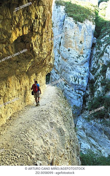 A hiker on the Congost (gorge) of Montrebei. Lerida province, Spain