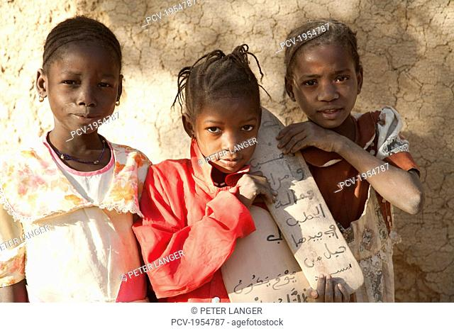 Children standing against the wall at Djenne, Mali