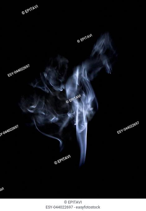 Abstract defocused white smoke ore vapor isolated on black background