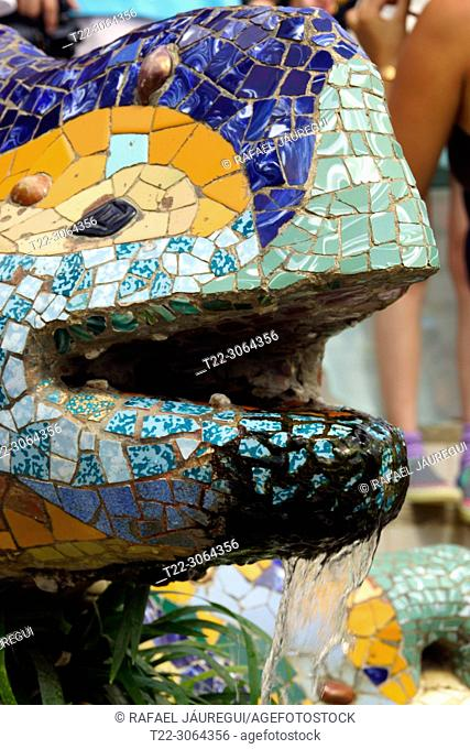 Barcelona, (Spain). Detail of the dragon or salamander made of brick slab covered with trencadís the Park Güell of the city of Barcelona