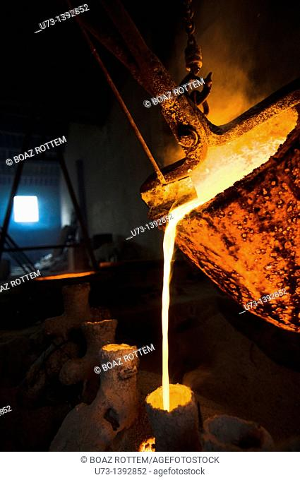 Liquid bronze poured into a cast in a foundry in China