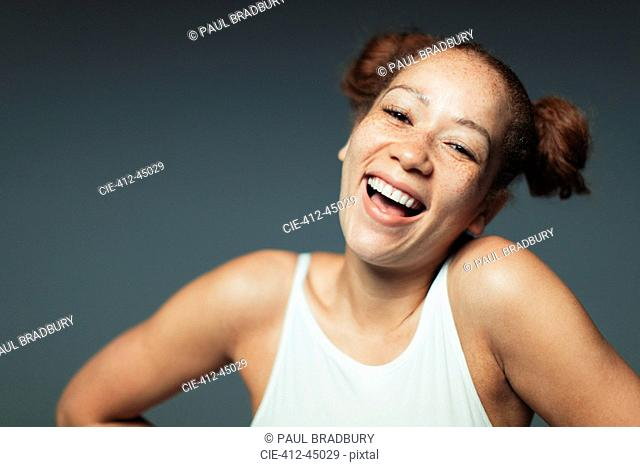 Portrait carefree woman with freckles laughing