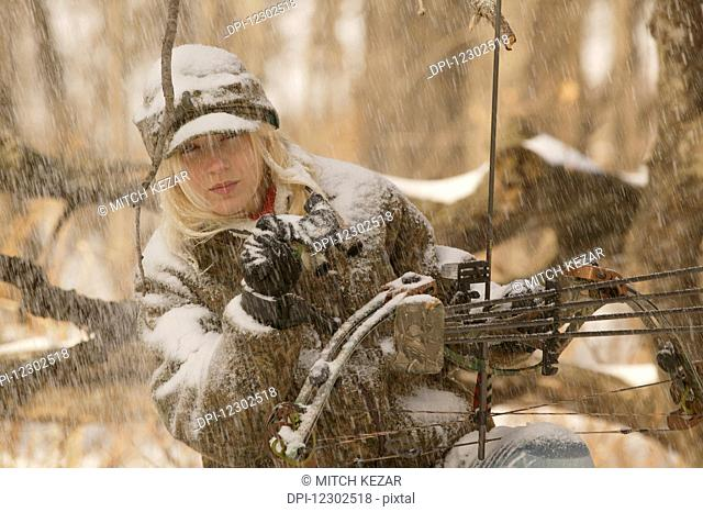 Woman Bowhunter In Snow