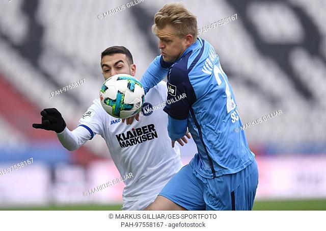 duels / Duell Burak Camoglu (KSC)/l. versus Thorsten Schulz (Aalen). GES/ Fussball/ 3. Liga: Karlsruher SC - VfR Aalen, 02.12