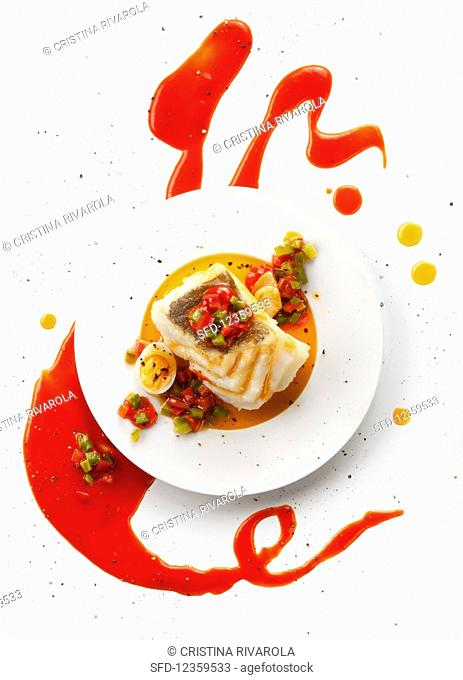 Cod with red tomato and pepper sauce (top view)
