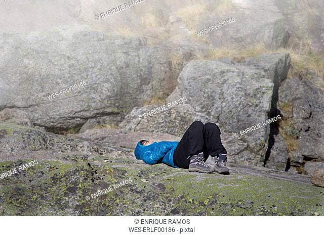Spain, Sierra de Gredos, woman resting in the mountains