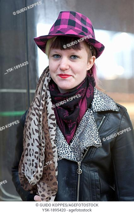 Rotterdam, Netherlands. Portrait of a young, fashionable woman at Rotterdam Central Station