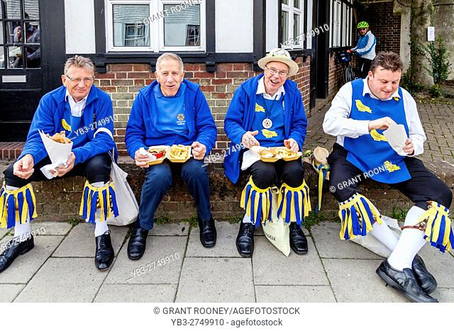 A Group Of Morris Dancers Enjoy A Fish and Chip Lunch Between Performances At The Lewes Folk Festival 2016, Lewes, Sussex, UK