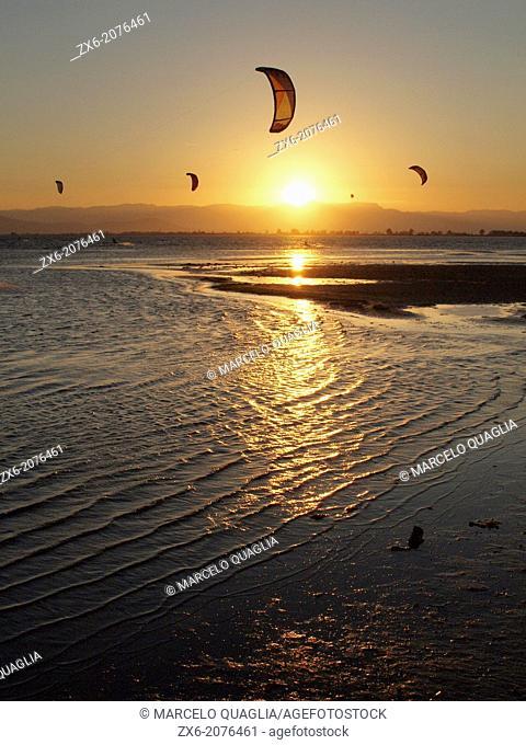 Sunset kitesurfing at Alfacs Bay. Ebro River Delta Natural Park, Tarragona province, Catalonia, Spain