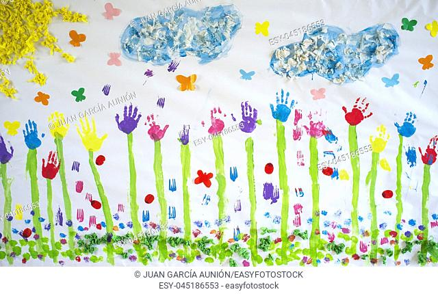 Spring mural draw over craft paper painted with hands prints. Made by nursery children