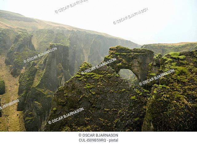 View of arch rock formation and canyons at Fjadrargljufur, Iceland