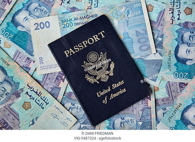 MOROCCO, CASABLANCA, 23.12.2015, American passport against a background of Moroccan Dirham banknotes. - CASABLANCA, MOROCCO, 23/12/2015