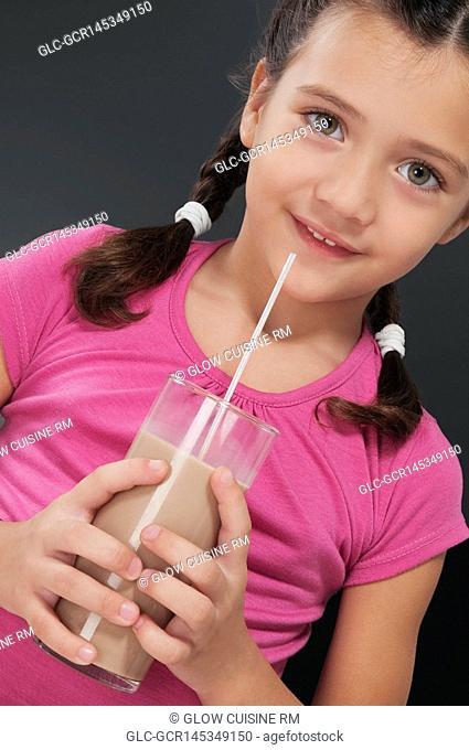 Girl drinking chocolate milkshake