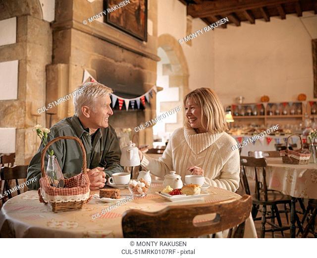 Older couple having lunch in restaurant