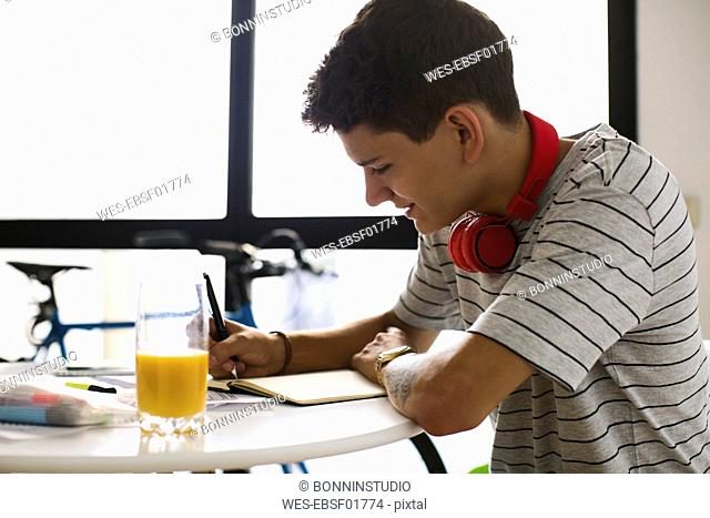 Teenage boy doing homeworks