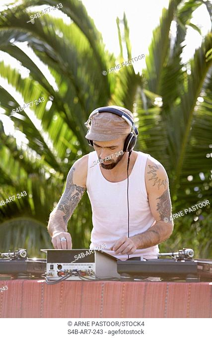 Disk jockey with headphones, Sao Teotonio, Alentejo, Portugal