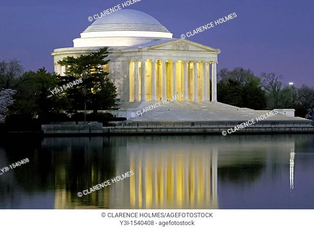 The Jefferson Memorial illuminated before sunrise on the Tidal Basin in Washington, DC, USA