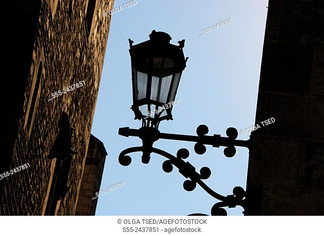 View of the Cathedral of Santa Eulalia and a streetlight in Barcelona in Gothic quarter, Catalonia, Spain