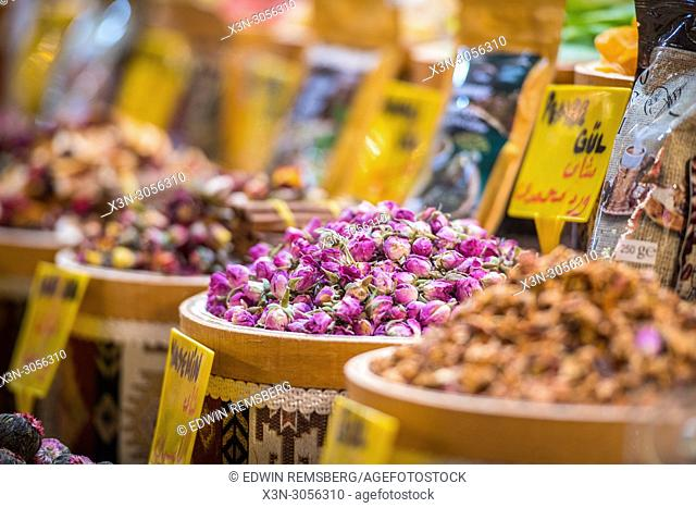 Bright-pink tea flowers fill wooden basket at Istanbul Spice bazaar in Turkey