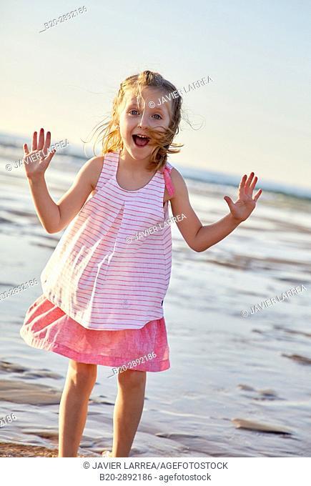 Girl playing on the beach, Zarautz, Gipuzkoa, Basque Country, Spain, Europe