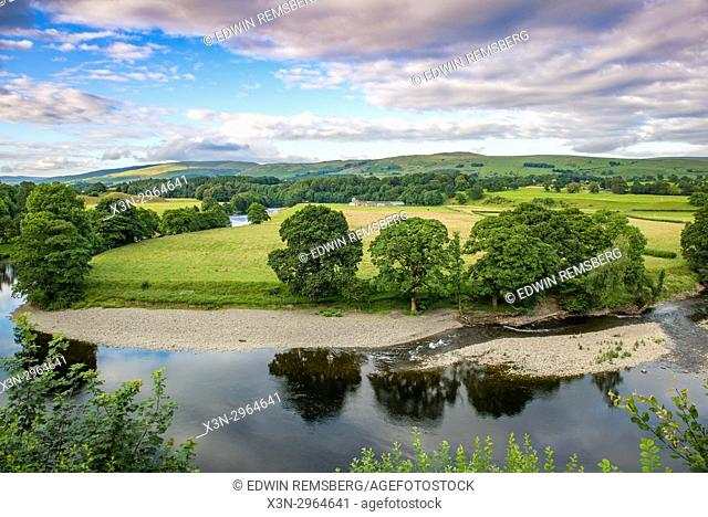 Breathtaking skies soar above stunning river vista , Kirkby Longsdale, Cumbria, England. The view of the River Lune from the churchyard in Kirkby Lonsdale