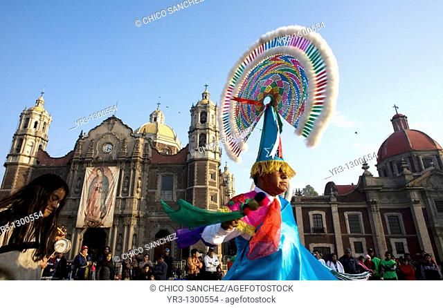 A Bird Men dances outside the Basilica of Guadalupe in Mexico City, December 11, 2007  'Bird Men' perform an ancient Totonacan ceremony asking for a good...