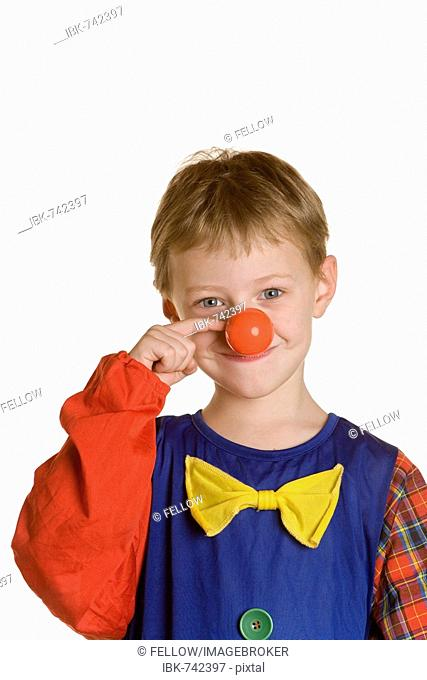 Four-year-old boy dressed up as a clown