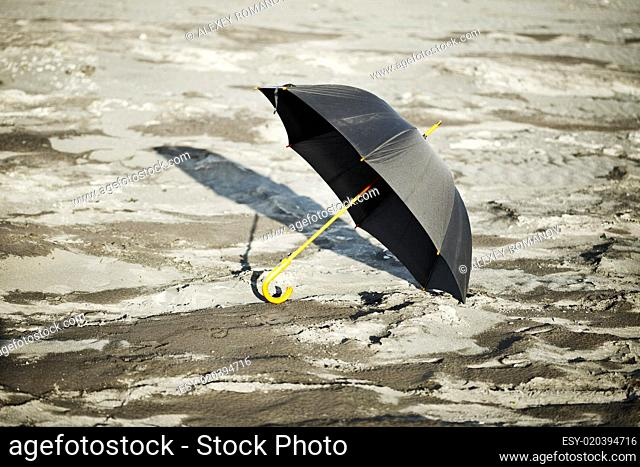 Large old-fashioned black umbrella