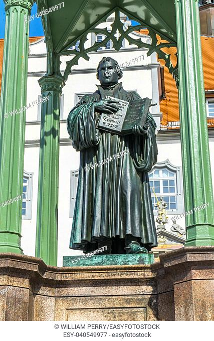 Martin Luther Statue, Colorful Market Square Rathuas Lutherstadt Wittenberg Germany. Statue from 1800s