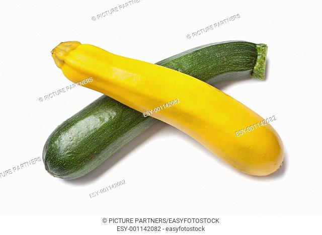 Yellow and green zucchini on white background